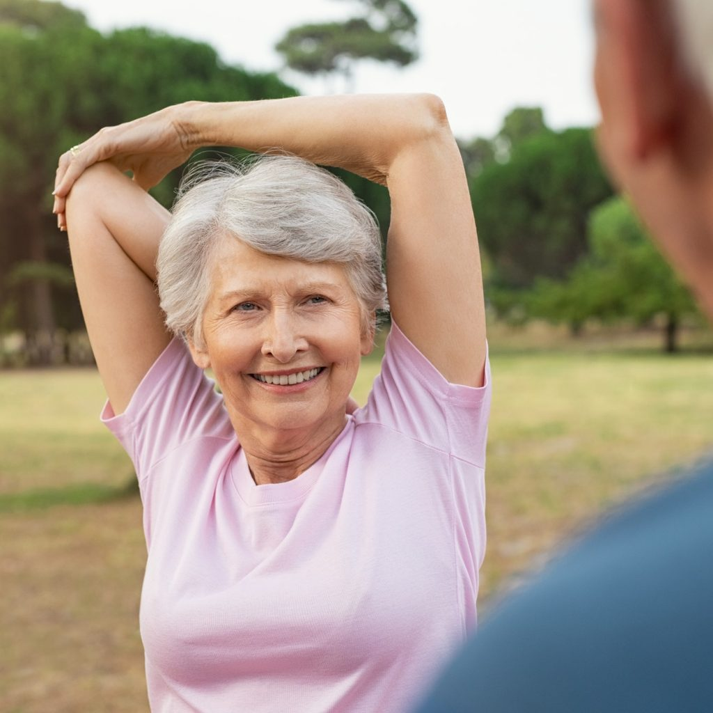 Senior woman stretching arms